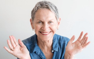 laughing elderly woman clapping