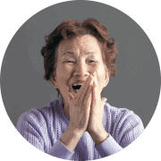 older asian woman clapping