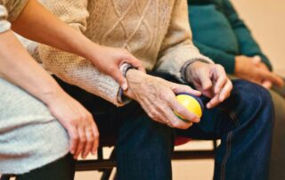 Elderly men and women in nursing home