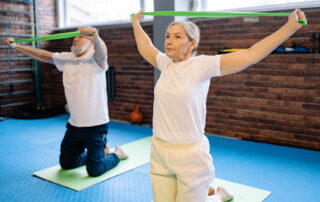 Senior couple exercising indoors during winter